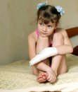 Sad little girl with bandaged hand Royalty Free Stock Image