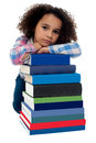 Sad little girl bored of reading getting after set books blank face expression Stock Photos