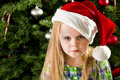 Sad little girl during christmas she didn t get what she wnated for and has a face Royalty Free Stock Photos