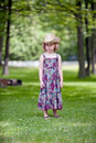 Sad little girl in cowboy hat under trees Royalty Free Stock Photography