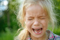 Sad little girl crying beautiful on summer background Stock Photos