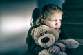 Sad little girl embracing her teddy bear - feels lonely Royalty Free Stock Photo