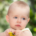 Sad little girl with a flower in the hands Royalty Free Stock Photo