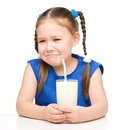 Sad little girl with a glass of milk isolated over white Royalty Free Stock Photos