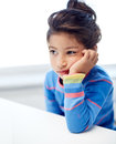 Sad little girl at home or school Royalty Free Stock Photo