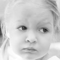 Sad little girl portrait of a beautiful pensive black and white photography Stock Images