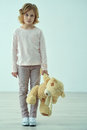 Sad little girl standing with bear Royalty Free Stock Photo