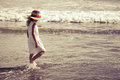 Sad little girl walking at the beach day time Royalty Free Stock Photography