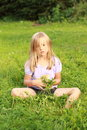 Sad little heary girl on grass Stock Images