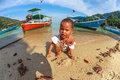 Sad lone baby mu ko surin national park thailand january child of chao leh or moken tribe playing on the beach of his village Royalty Free Stock Image
