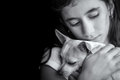 Sad lonely girl hugging her small dog Royalty Free Stock Photo