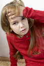 Sad and lonely little sick girl Stock Images