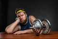 Sad man with a dumbbell Royalty Free Stock Photo