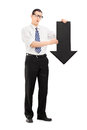 Sad man holding a big black arrow pointing down full length portrait of isolated on white background Royalty Free Stock Photography
