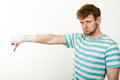 Sad man showing thumb down by bandaged hand. Royalty Free Stock Photo