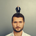 Sad man with small man on the head portrait of men men Stock Photography