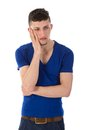 Sad man is thinking with hand against his head isolated on white Stock Image