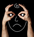 Sad mood and unhappy face with hands on black background a an expression of unhappiness drawn by hand solid Royalty Free Stock Images