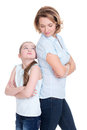 Sad mother and daughter having problem or quarrel standing back to back studio isolated on white Stock Photos