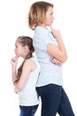 Sad mother and daughter having problem or quarrel standing back to back studio isolated on white Stock Images