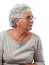 Sad old woman portrait of a in glasses side view isolated on white background Stock Images