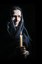 Sad old woman senior in sorrow with candle depressed portrait Royalty Free Stock Photos