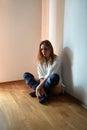 Sad pensive woman sitting on floor Royalty Free Stock Photos