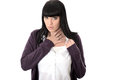 Sad poorly miserable woman with sore throat or chest infection long straight black hair and hispanic or european features Royalty Free Stock Photography