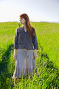 Sad redhead woman in grass Stock Photography