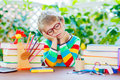 Sad school kid boy with glasses and student stuff Royalty Free Stock Photo