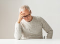 Sad senior man sitting at table Royalty Free Stock Photo