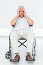 Sad senior man sitting in wheelchair at the medical office Stock Images