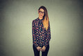Sad shy insecure woman in glasses looking down avoiding eye contact young standing isolated on gray wall background Stock Images