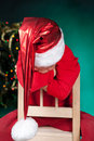 Sad small boy in santa hat Royalty Free Stock Image