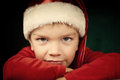 Sad small boy in santa hat Stock Images