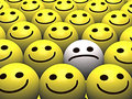 Sad smiley in a crowd of happy smileys Royalty Free Stock Photography