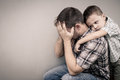 Sad son hugging his dad Royalty Free Stock Photo