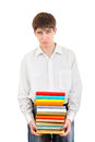 Sad student holding pile of the books isolated on white background Stock Photo