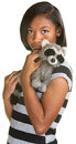 Sad teen with toy hispanic teenage girl holding plush raccoon doll Royalty Free Stock Photography