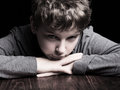 Sad teenage boy portrait on a black background Royalty Free Stock Photography