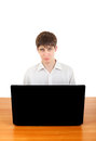 Sad teenager behind laptop at the desk with isolated on the white background Stock Image