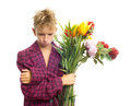 Sad teenager with bouquet a of flowers Stock Image