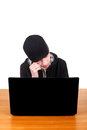 Sad teenager with laptop young man is weeping at the desk isolated on the white background Stock Image