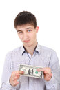 Sad teenager with one dollar dissatisfied isolated on the white background Royalty Free Stock Photos