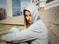 Sad teenager portrait of a lonely girl in the city Stock Images