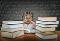 Sad tired busy little girl with big eyes wearing glasses sitting in the pew next to him many many books Royalty Free Stock Images