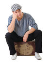 Sad waiting young male traveler on vintage suitcase Royalty Free Stock Photography