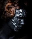Sad woman with black painted face in carnival mask Royalty Free Stock Photo