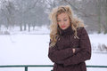 Sad woman freezing in winter heavy snowfall suffering from depression Royalty Free Stock Photography