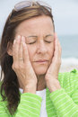 Sad woman in grief and sorrow with closed eyes portrait attractive mature stressed depressed facial expression Stock Photos